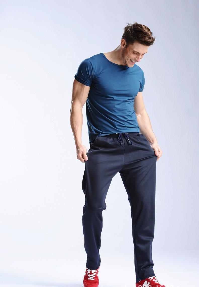 Uwback 17 Plus Size 4XL New Sweat Pants Men Joggers Pants Elastic Waist Loose Sweat Pants For Men Casual Trousers homme CAA329 6
