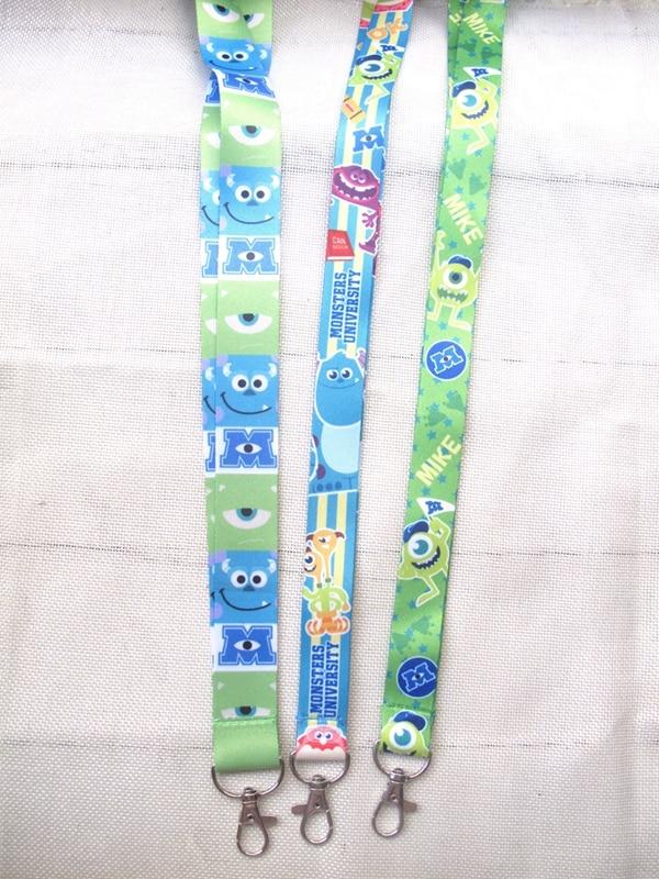 50 pièces/lots en gros dessin animé oeil vert Anime collier sangle longes téléphone portable PDA clé ID sangle charmes