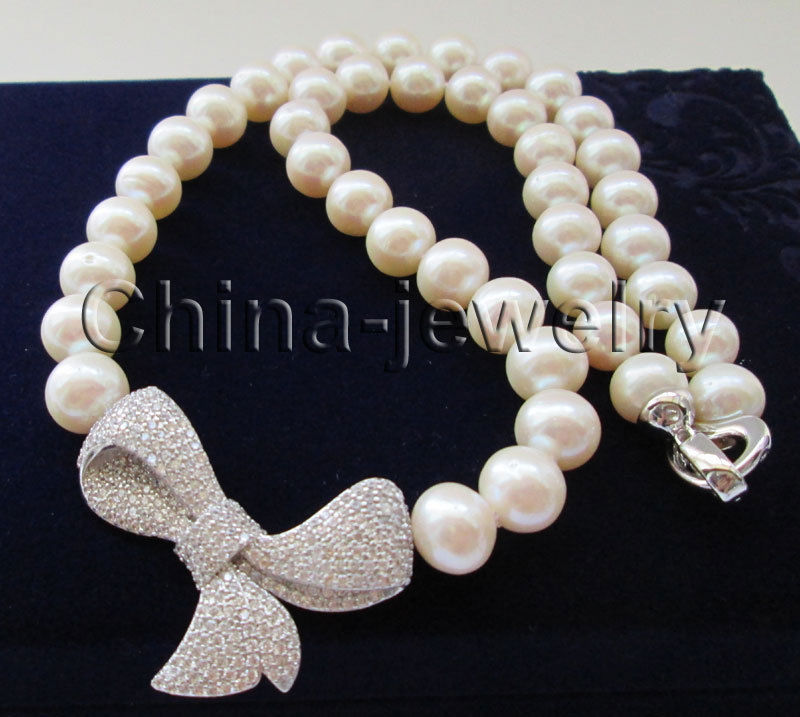 P7342-18 10-11mm natural white round freshwater pearl necklace -Bowknot pendantP7342-18 10-11mm natural white round freshwater pearl necklace -Bowknot pendant