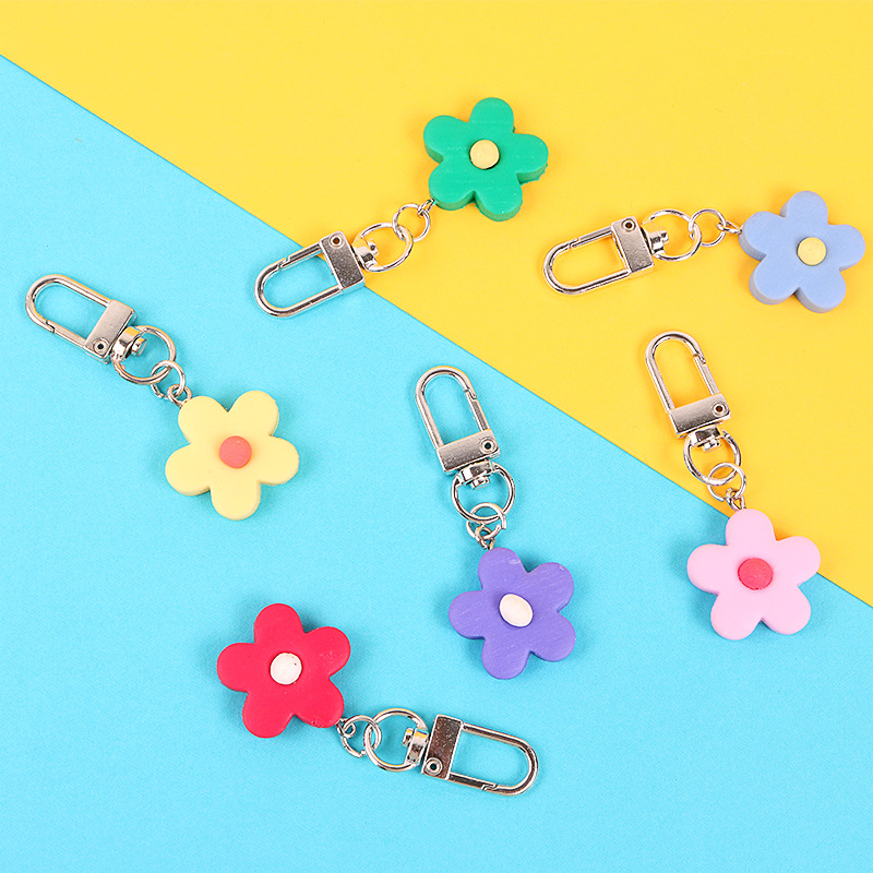 High Quality 2019 New Genuine Leather Black White Male Female Bag Plush Car Key Ring Car Key Camellia Flower Hat Tassel Style in Key Chains from Jewelry Accessories