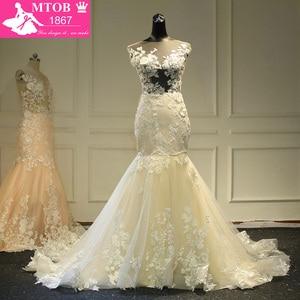 Image 1 - Champagne Mermaid Lace Wedding Dress 2019 Backless See Through Vestidos de novia Robe De Mariage MTOB1734