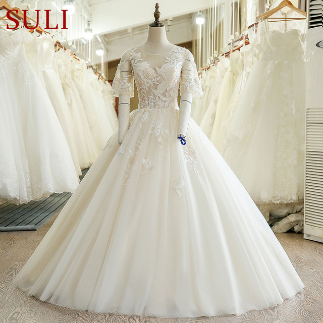 fd41646fb14 SL-229 Puffy Short Sleeve Lace Illusion Bodice Plus Size Wedding Dress 2017