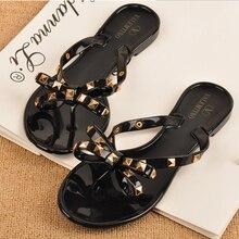ยุโรปรองเท้าวุ้นรองเท้าแตะหยิกใหม่หมุดโบว์flip-flopฤดูร้อนผู้หญิงที่มีชายหาดรองเท้ากันลื่นเย็นรองเท้าแตะ