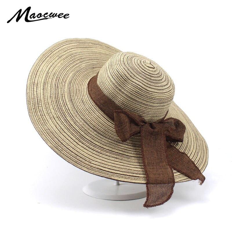 bf8cb898 2018 Venta caliente ronda Top rafia sombreros de paja de ala ancha  sombreros de Sol de verano para ...