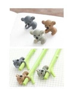 Image 4 - 35 adet/grup Sevimli koala ayı jel mürekkep kalemler yazma Karikatür siyah kalem 0.5mm Kawaii kırtasiye Ofis Okul malzemeleri FB719