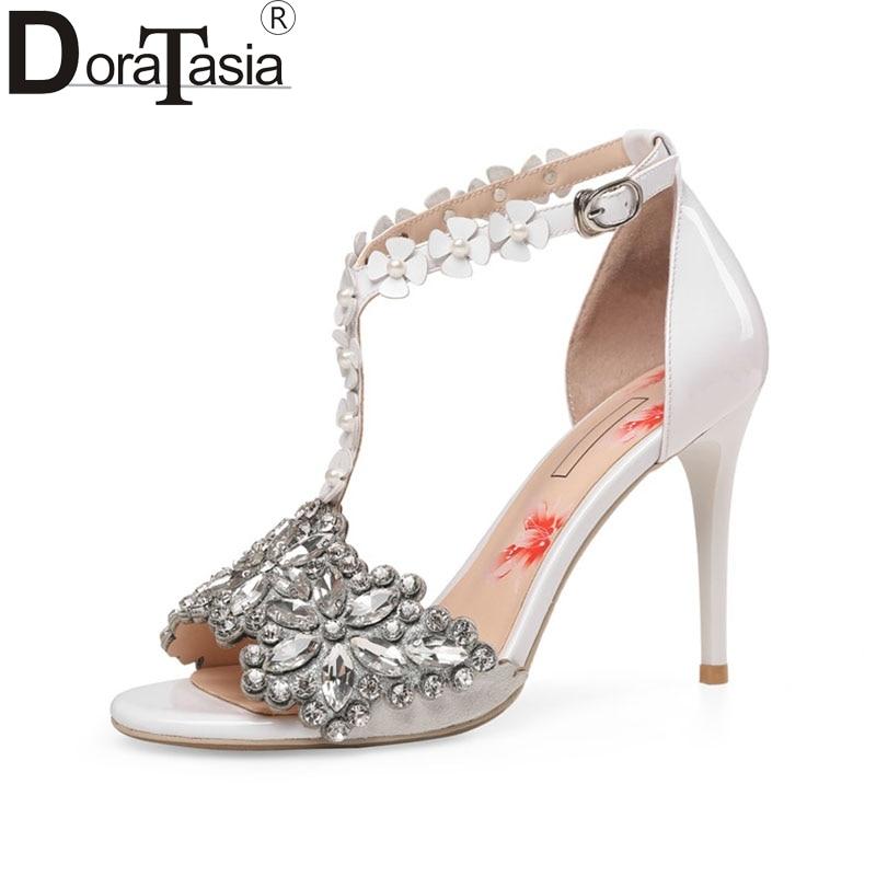 цена DoraTasia 2018 Summer Brand Genuine Leather T-strap Sandals Bling Crystal High Heels Shoes Woman Flower Appliques Women Shoe онлайн в 2017 году