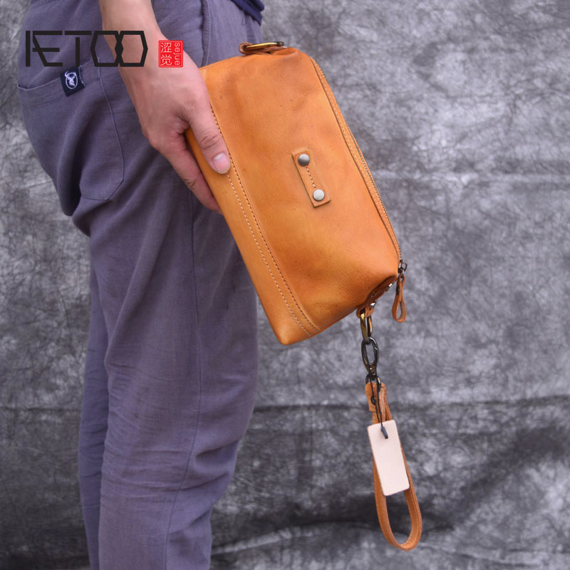 3abf6cdf336f aetoo new leather men s bag hand retro vegetable tanned leather clutch bag  casual large capacity female bag купить по лучшей цене