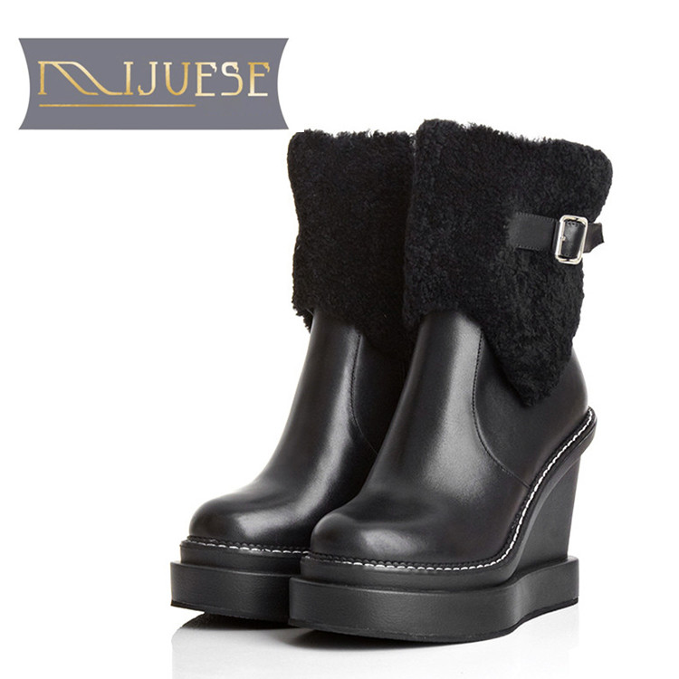 цена на MLJUESE 2019 women Mid calf boots cow leather buckle strap winter wool short plush warm platform wedges women martin boots