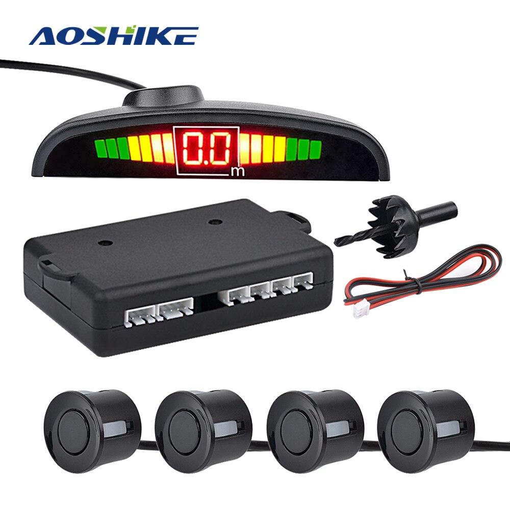 Sensor de estacionamiento automático AOSHIKE, Sensor de estacionamiento con luz LED con 4 sensores de marcha atrás, sistema de detección monitorizado con pantalla de Radar