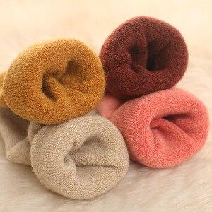Image 2 - 4 زوج ميرينو العلامة التجارية الصوف سميكة الجوارب الدافئة المرأة اليابانية نمط الشتاء الكشمير النساء الجوارب أنبوب النعال بسيطة نمط طاقم