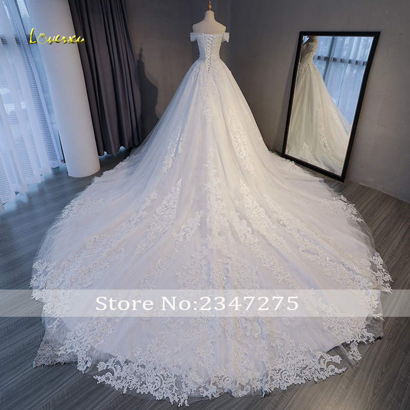 Image 2 - Loverxu Gorgeous Appliques Lace Chapel Train A Line Wedding Dress 2020 Luxury Beaded Boat Neck Sexy Bridal Gown Vestido de NoivaWedding Dresses   -