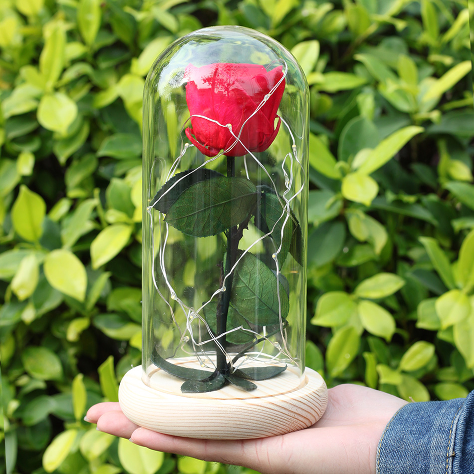 a glowing valentines day gift was on the glass of the box that kept the flowers