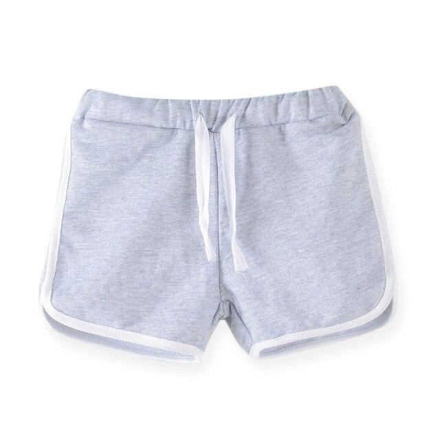 SheeCute abbigliamento bambini nuovo ragazze colore della caramella breve ragazzi di estate pantaloni spiaggia pantaloni di bicchierini 0902 3
