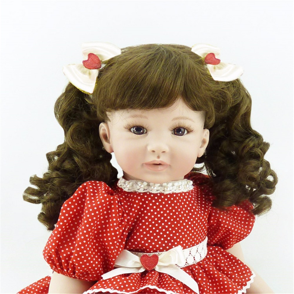 22 inch 55cm Silicone baby reborn dolls Childrens toys red dot princess skirt girl with curly hair22 inch 55cm Silicone baby reborn dolls Childrens toys red dot princess skirt girl with curly hair