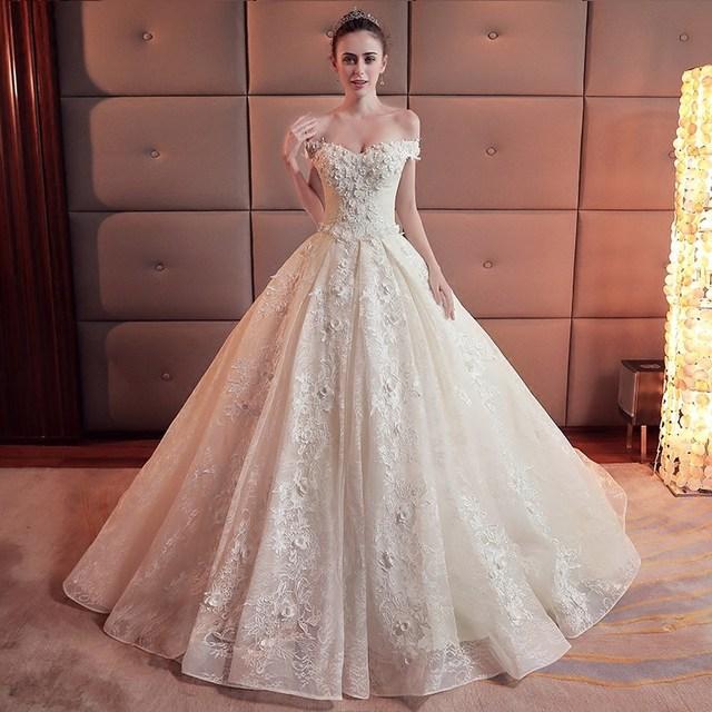 5c2f892dc Champagne de encaje vestido boda flor Tribunal tren Primavera 2019 estilo  coreano barco cuello grande tamaño Simple elegante la