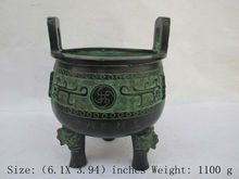 The ancient Chinese bronze. Dragon three legs censer