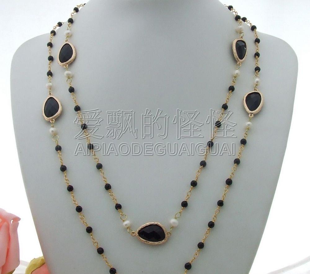 N022302 collier en cristal donyx noir perle blanche 45N022302 collier en cristal donyx noir perle blanche 45
