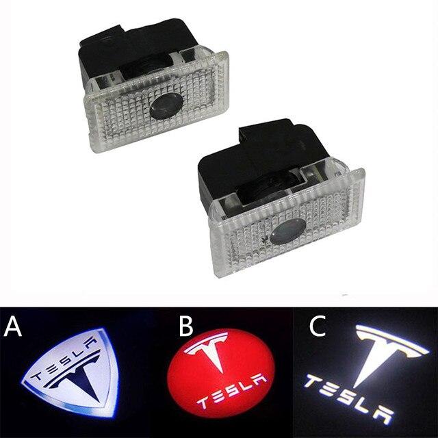 ترحيب مصباح سيارة Led المجاملة باب السيارة مصباح إشارة البركة أضواء كشاف ضوء شبح الظل أضواء ل تسلا نموذج S X(2 قطعة)