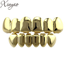 XINYAO Oro Argento di Colore HIP HOP Denti Grillz Superiore e Inferiore Groll Set Con Silicone Denti del Vampiro Hallowmas Del Partito Dei Monili(China)