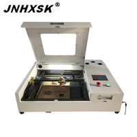JNHXSK Chinese 50W CO2 mini laser engraving and cutting machine for sale cheap desktop mini machine for Acrylic M2 control