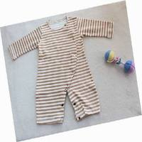 Natural Organic Cotton Colored Fabric The Pajamas Are Carried By The Baby Bed Sheets