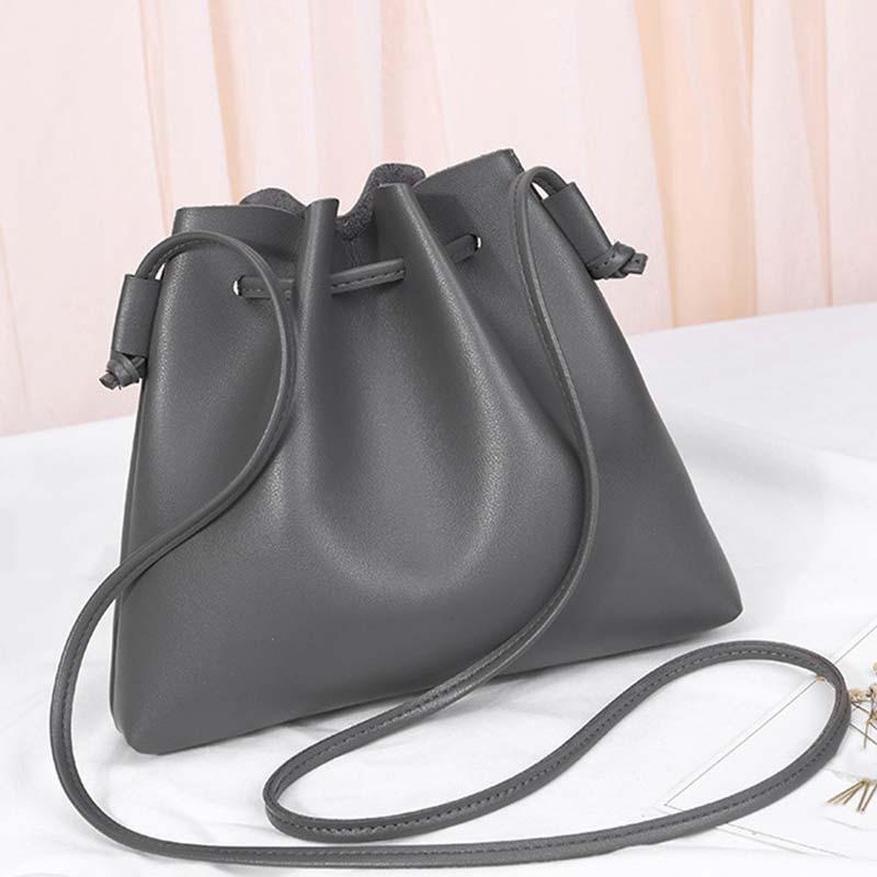 цены на Women Messenger Bag PU Leather Solid Color Tassel Bucket Handbags Lady Casual Crossbody Shoulder Bags BS88 в интернет-магазинах