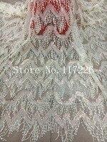 Heißer verkauf fabrik französisch nettospitzegewebe qualität tüll stoff mit fransen pailletten für nigerianischen hochzeitskleid