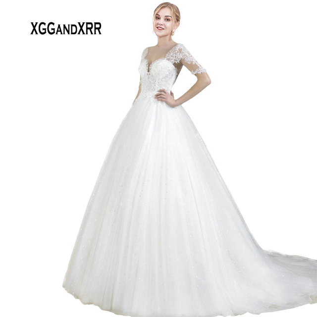 XGGandXRR Romantic Half Sleeves A Line Tulle Wedding Dresses 2019 Appliques Illusion Zipper Back with Buttons Long Bridal Gown