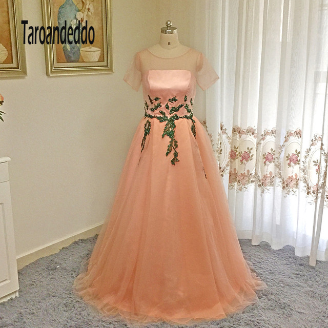 06836bfdeaf See Through Short Sleeves Nude Pink A-line Tulle Prom Dress Green Lace  Applique Waistline with Crystals Evening Dress Formal