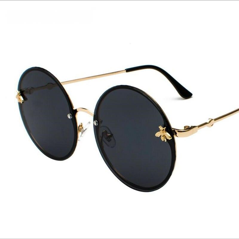 KAPELUS 2018 lunettes de soleil rondes montrent une paire mince et bien assortie de lunettes de soleil sans monture