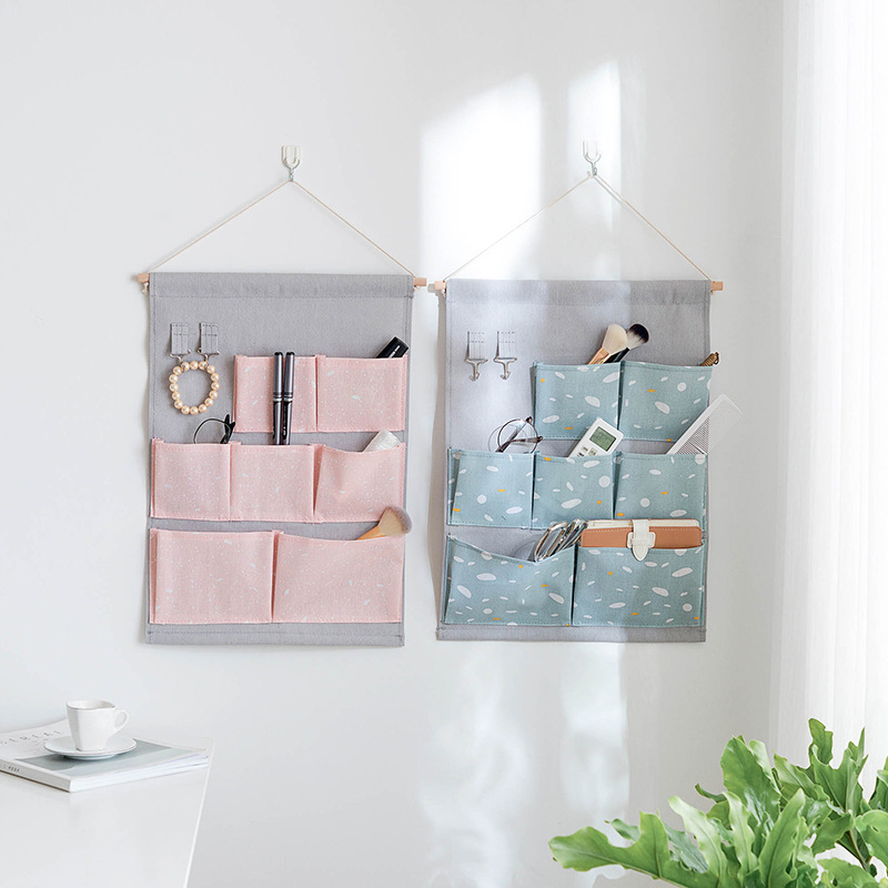 Fashion snow printing Cotton Linen Hanging Storage Bag 7 Pockets Wall Mounted Wardrobe Hang door Pouch lovely Toys Organizer