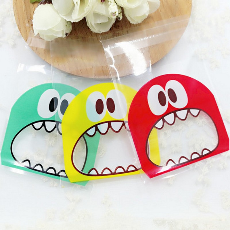 100pcs 7cm 10cm OPP Cute small Monster Sharp teeth Baking Christmas Gift Packaging Bags Wedding Cookie Candy Plastic bag B136 in Gift Bags Wrapping Supplies from Home Garden