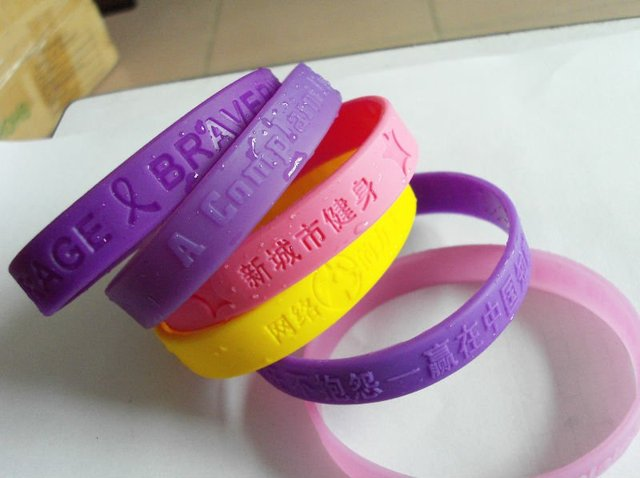 100pcs Lot Custom Rubber Bracelet Silicone Eg Wbe001 Embossed Text Hand Bands Personalized Logo