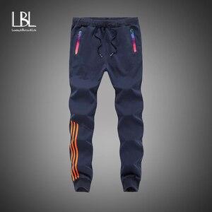 New Trousers Men Fashion Tracksuit Bottoms Casual Pants Cotton Sweatpants Mens Joggers Striped Pants Gyms Trousers Plus Size 5XL