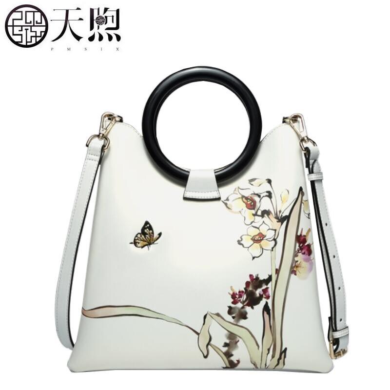 Pmsix2018100% high-quality high-grade leather fashion luxury brand new summer handbag white personality atmosphere ring handbag marsnaska fashion new high quality white