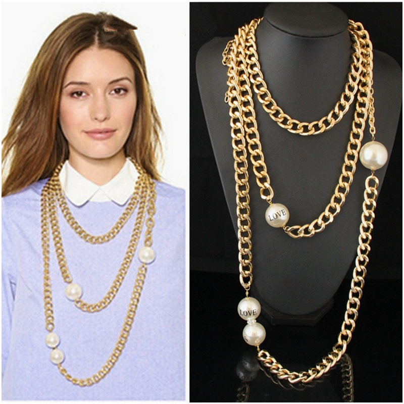 Large pearl on gold coloured chain Choker necklace