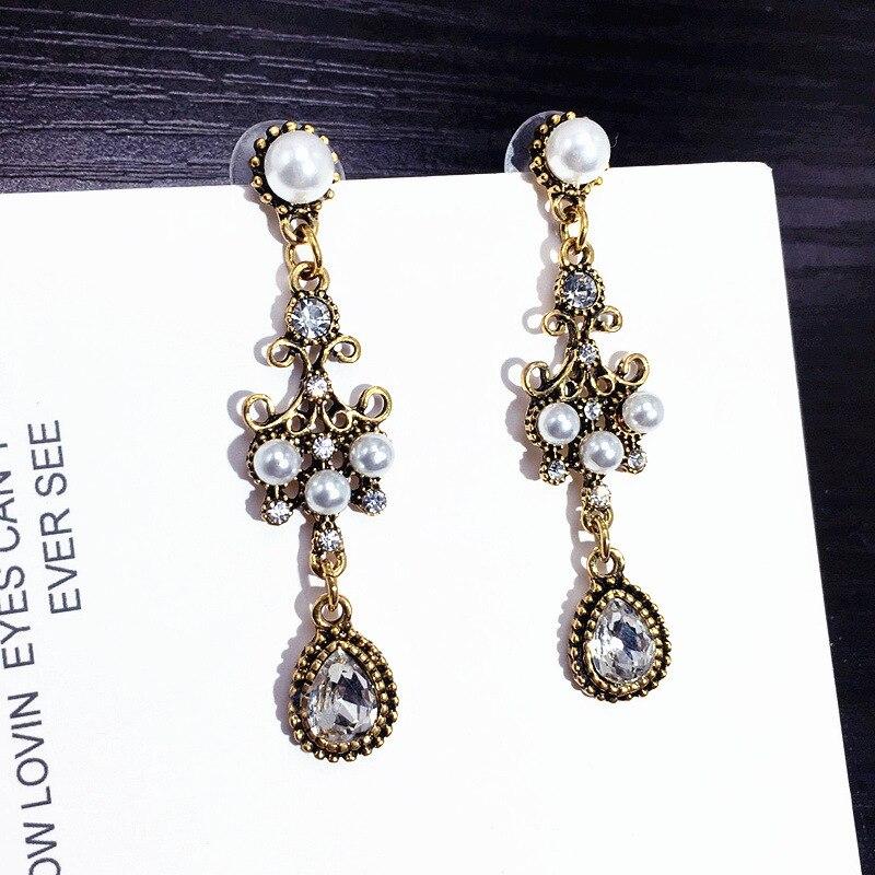 Pendientes largos de perlas con borla, cristal de viento étnico, antialergia no se desvanecen, accesorios de joyería de moda al por mayor, TF258