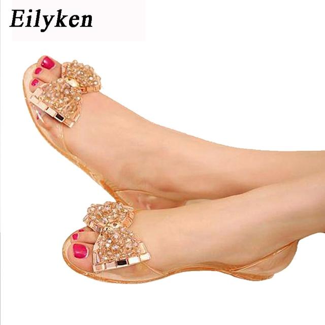 Eilyken Phụ Nữ Dép Mùa Hè Phong Cách Bling Bowtie Thạch Giày Phụ Nữ Giản Dị Peep Toe Sandal Pha Lê Giày Phẳng Kích Thước 35- 40