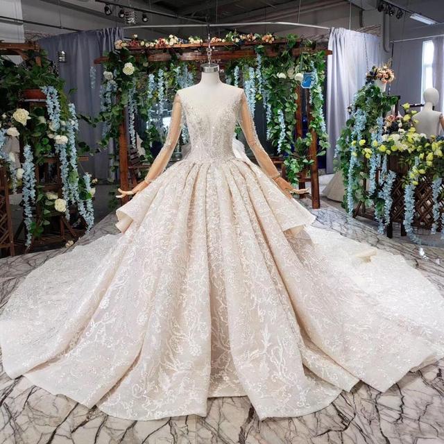 2019 Arabe Robe De Bal Robes Mariee Paillettes Dentelle Appliques Chine Designer Cristal Perle Dubai Princesse Luxe