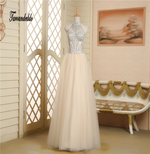 Halter Neckline See Through Beading A Line Champagne Prom Dress Exposed Boning Long Evening Gowns