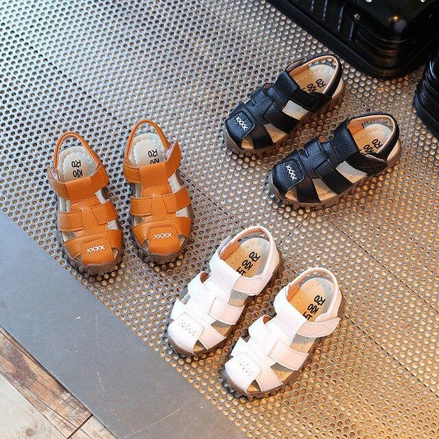 עור סנדלי בני 2019 100% רך עור בקיץ החדש בני ובנות ילדי חוף נעלי ילדים ספורט סנדלי נסיכת s