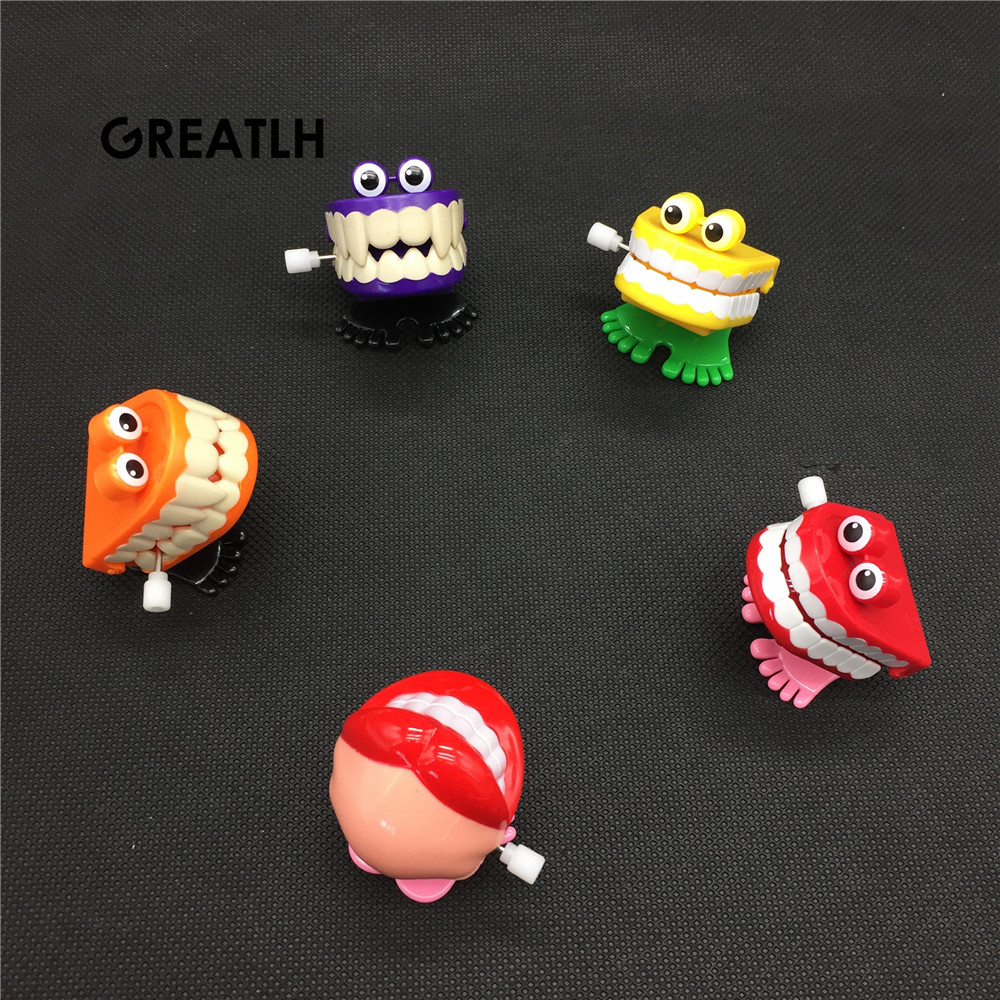 Toys Wholesale Creative Dental Gift Wholesale Spring Plastic Toys Jump Teeth Chain For Children Dental Toys