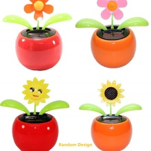 ffa2b5481 New Solar Powered Flip Flap Dancing Flower For Car Decor Automatic Dancing  Flower Toy Gift-