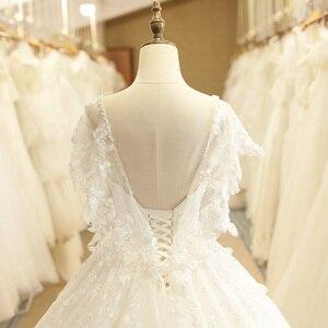 Image 5 - SL 7805 осень Пышный рукав с открытой спиной кружевной аппликацией Иллюзия лиф v образным вырезом Свадебное платье 2017