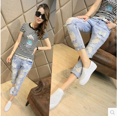 In the autumn of 2015 new Korean all-match thin women wear white hole nine feet pencil pants