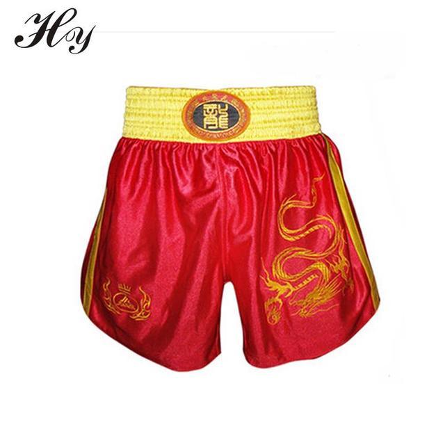 7445d1eb75 Bordado dragón boxeo pantalones cortos para hombres mujeres Muay Thai MMA  Boxe corta troncos deportes Sanda