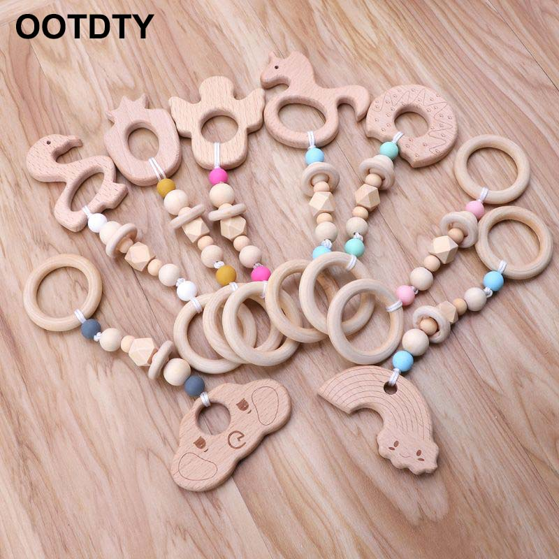 Baby Teether Animal Teething Bracelet Nursing Chew Beads Rings Wooden Toys DS