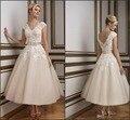 2016 Justin champán longitud de té vestidos elegante cuello en V Vintage encaje corto Backless bola vestidos de novia con la correa