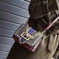 Bag 2017 new snake grain small square package Europe and the United States fashion rivet female bag chain handbag 931