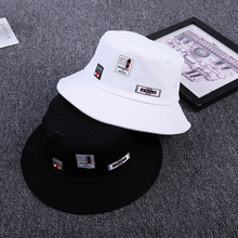 db333fc9904 2018 Spring and summer new Korean label fisherman hat men and women flat  top folding outdoor vocation holiday visor Bucket hat